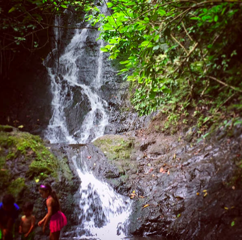 children playing in front of Likeke Falls