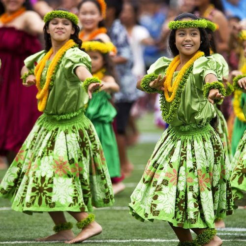 two hula dancers in green outfits