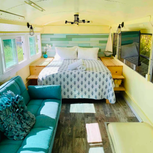 yellow and blue bus interior with bed
