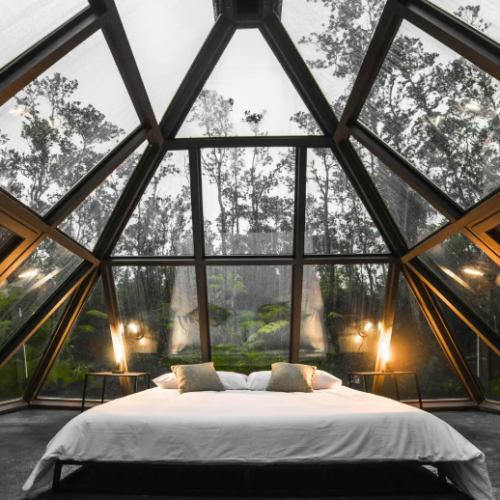 glass pyramid with large bed in rainforest Airbnbs in Hawaii