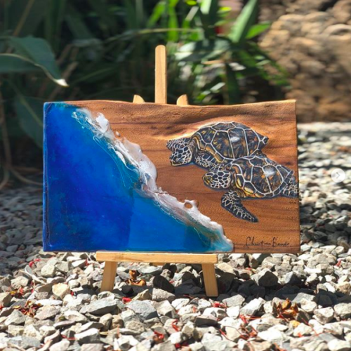 artwork on wood with two turtles entering ocean by Hawaii Artist Christian Bendo