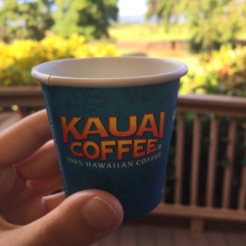 hand holding Kauai Coffee cup Hawaii farms
