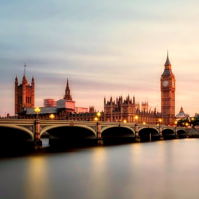 Big Ben and Houses of Parliament in London illuminated by rosy sunset