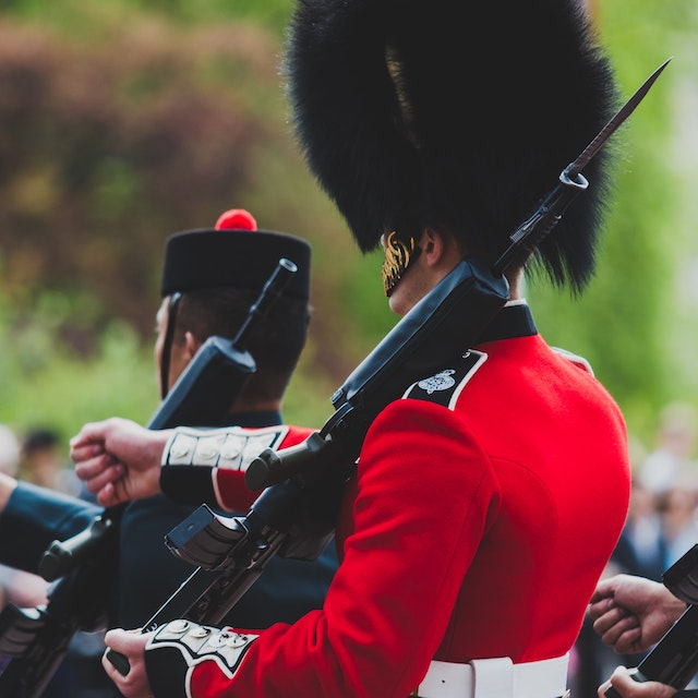 guard marching as part of the changing of the guard ceremony at Buckingham Palace
