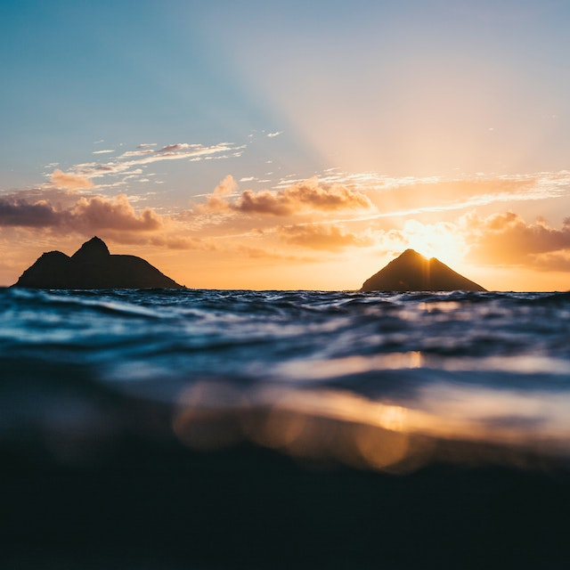 sunrise behind Mokulua Islands on Oahu Warm Winter Vacations in the USA