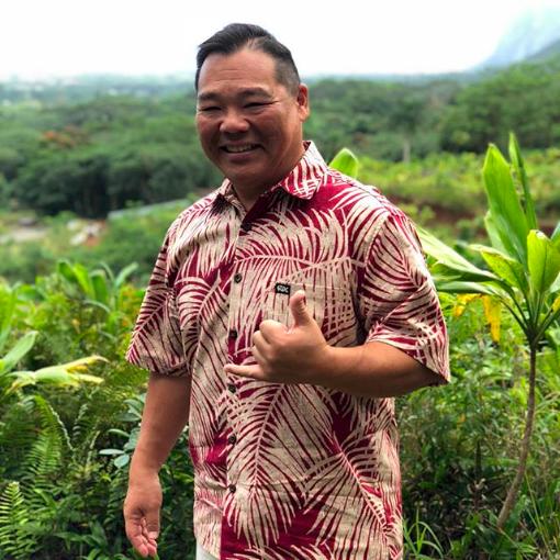 man in red Rix Island Wear shirt