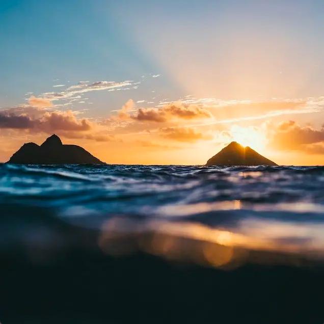 Lanikai Beach Mokulua Islands with sunrise in the background