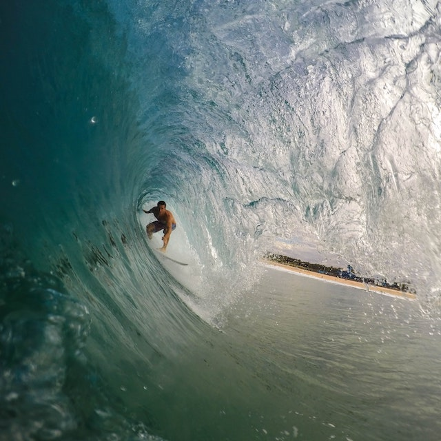 surfer inside a wave things to do on the North Shore Oahu Hawaii