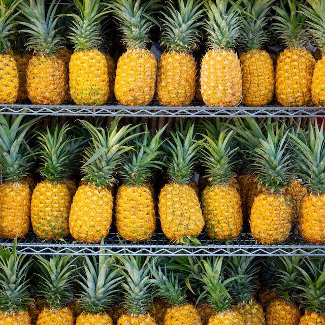shelves of golden pineapples