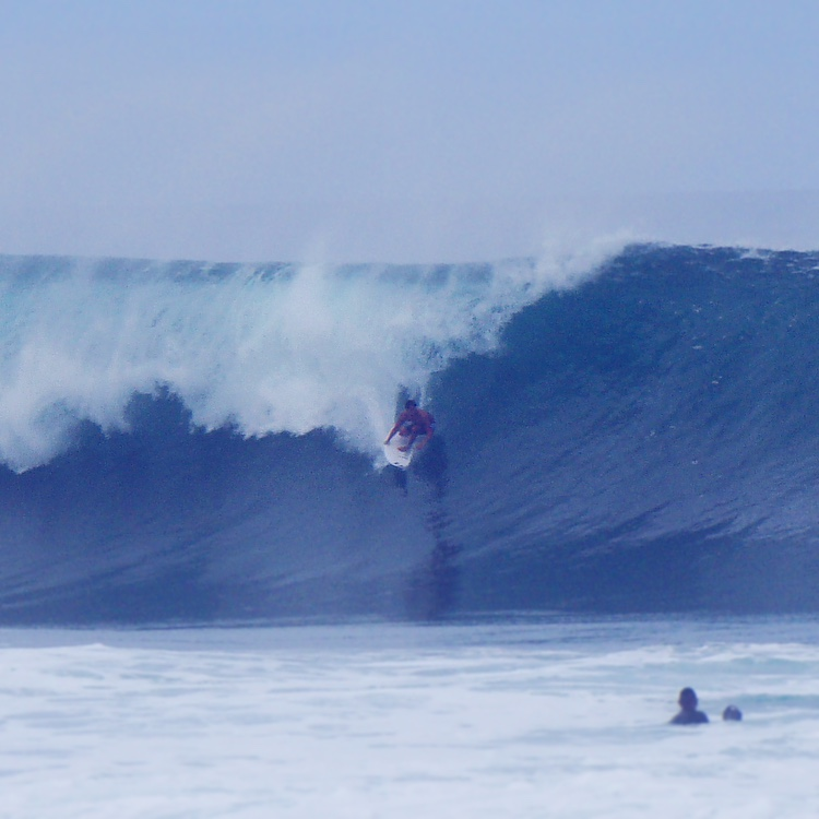 surfer at Banzai Pipeline best time to go to Hawaii