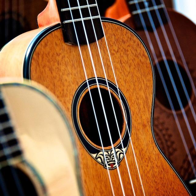 three ukuleles of varying wood shades