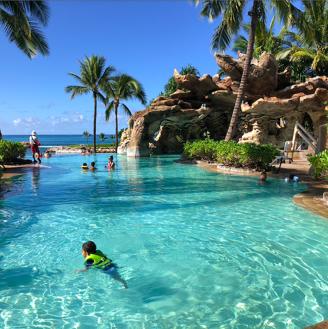kids swimming at pool at Aulani Disney Resort Hawaii