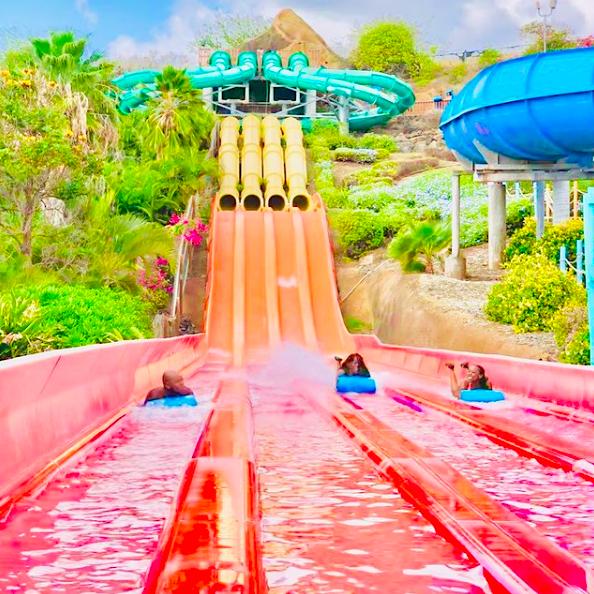 people racing down waterslides at Wet 'n' Wild Hawaii best Hawaii amusement parks