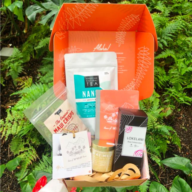 bright orange mana up Hawaii box with snacks, tea, honey, and beauty products
