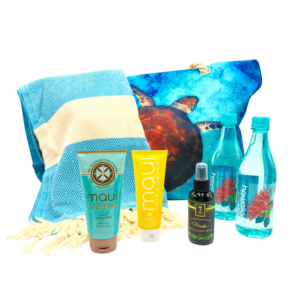 Beach-themed gift basked with towel, sunscreen, water, and more from Maui's Finest Gifts