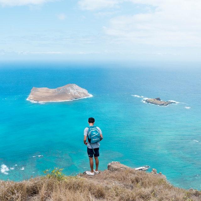 person looking at rabbit island Hawaii