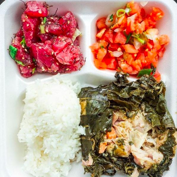 styrofoam container with poke, rice, lomi lomi salmon, and laulau