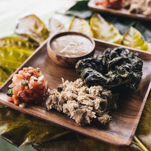 plate of laulau, poi, lomi lomi salmon, kalua pig at one of the best Hawaiian restaurants in Hawaii
